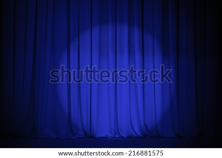 theater blue curtain with light spot - stock photo