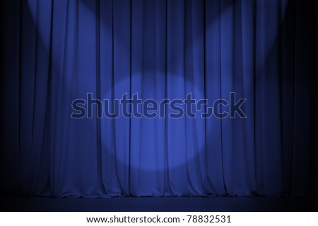theater blue curtain with two lights cross - stock photo