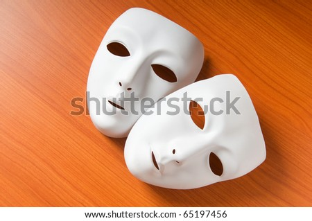 Theater concept with the white plastic masks - stock photo