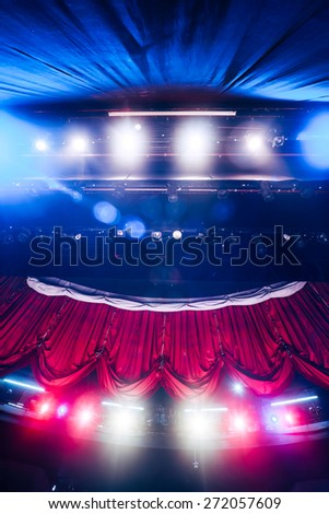 Theater curtain and stage with dramatic lighting - stock photo