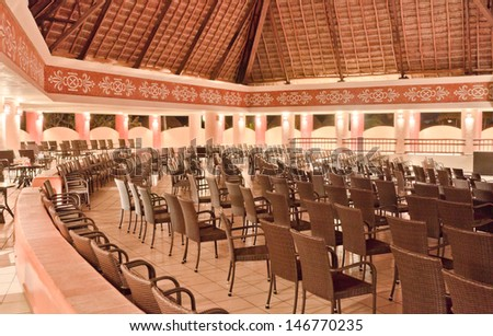 Theater interior.  Rows of chairs facing theatrical scene, stage.  Old theater of the luxury caribbean resort. Bahia Principe, Riviera Maya, Mexican Resort.
