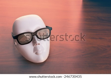 Theater mask in glasses  - stock photo