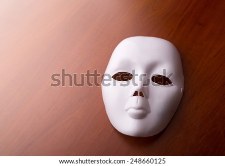 Theater mask on the table - stock photo