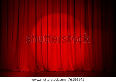 theater red curtain with spotlight - stock photo