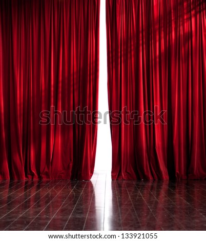 Theater red curtains slightly open - stock photo