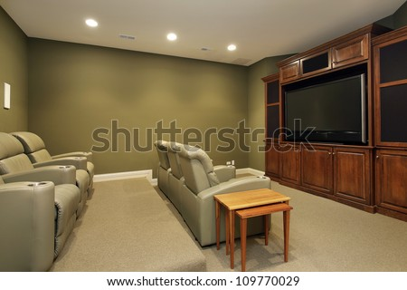 Theater room in luxury home with leather chairs - stock photo