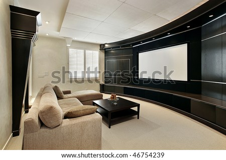 Theater room in luxury home with wide screen - stock photo