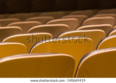 Theater seats in rows from back view - stock photo