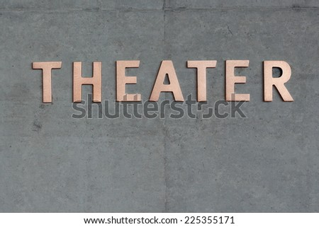 Theater Sign lettering on concrete wall - stock photo