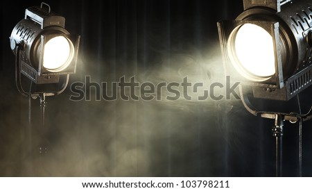 theater spot lights on black curtain with smoke - stock photo