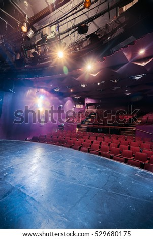 Theater stage and seats with dramatic lighting