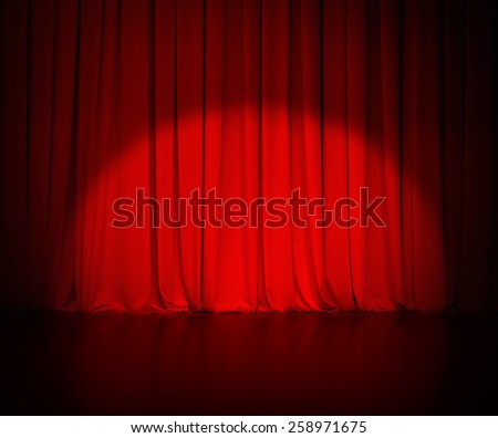 theatre red curtain or drapes background with light spot - stock photo