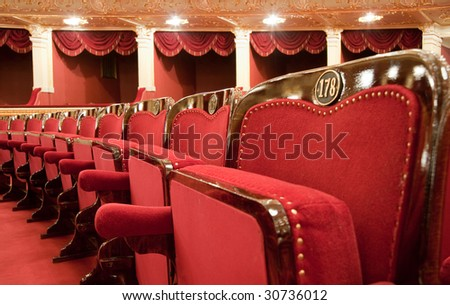 Theatrical armchairs. An interior of opera theatre. Odessa, Ukraine - stock photo