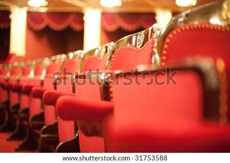 Theatrical armchairs. An interior of opera theatre. Odessa, Ukraine - stock photo