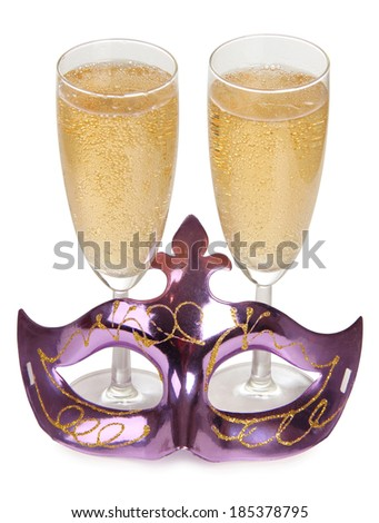 Theatrical mask and champagne glass on a white background - stock photo
