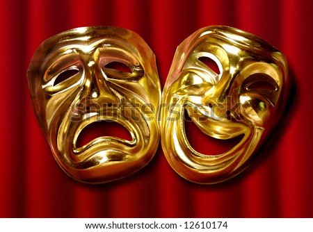 theatrical mask of tragedy and comedy over a red curtain - stock photo