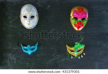 theatrical masks on a black background - stock photo