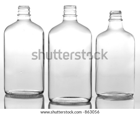 Thee glass bottles - stock photo