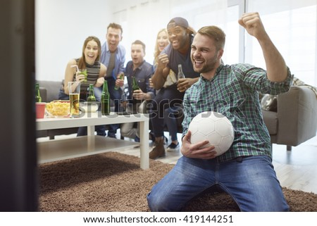 Their favorite team is the winner today - stock photo