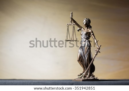 Themis figure on brown background - stock photo