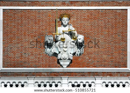 Themis (Justice symbol) between the Venetian lions on St Mark's Campanile, Piazza San Marco, Venice