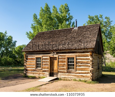 Theodore Roosevelt's Maltese Cross Cabin in Theodore Roosevelt National Park near Medora, North Dakota - stock photo