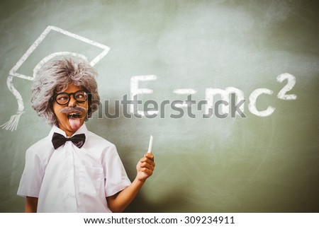 Theory of relativity against boy dressed as senior teacher in front of blackboard - stock photo