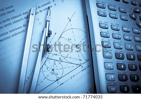 Theory of trigonometry paper with a compass and calculator - stock photo
