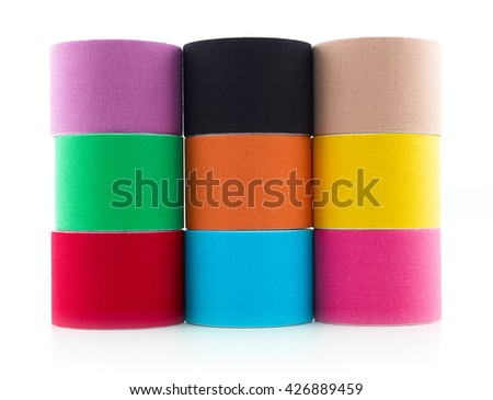 Therapeutic self adhesive tape for, aches and tension. It is also used for prevention and treatment in competitive sports. - stock photo