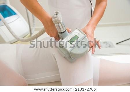 Therapist applying lipo massage LPG treatment - selective focus narrow DOF - stock photo