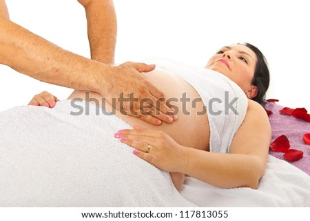 Therapist doing massage to pregnant woman tummy against white background - stock photo