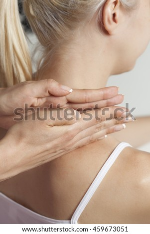 Therapist giving a massage on a woman in office
