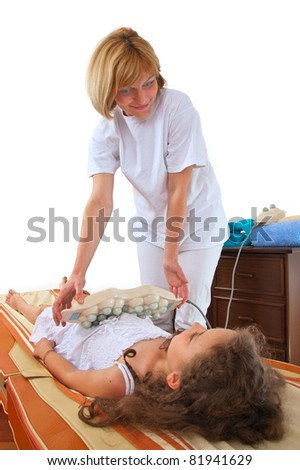 Therapist giving a massage to a girl