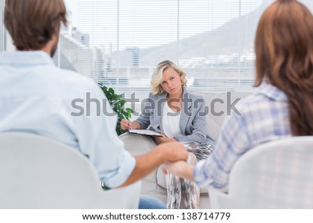 Therapist listening to couple with intent during a session