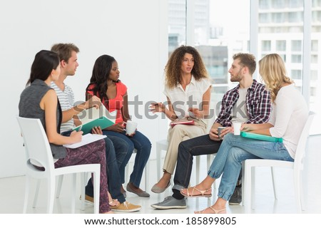Therapist speaking to a rehab group at therapy session - stock photo