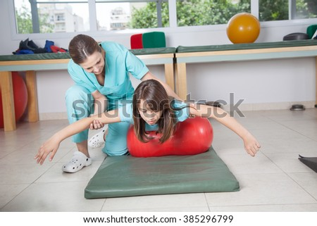 Therapist woman with girl in rehab