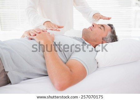 Therapist working with man in medical office - stock photo