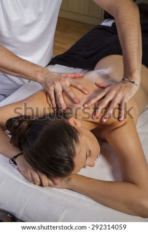 Therapy. Masseur doing massage on woman body in the spa salon. Beauty treatment concept. - stock photo