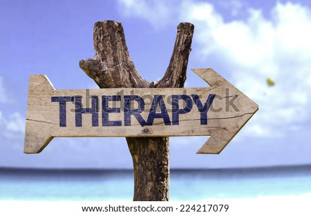 Therapy wooden sign with a beach on background - stock photo