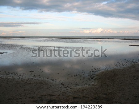 There are clouds, sly, skyline and a lake - stock photo