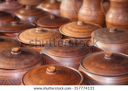 There are many clay pots on the table - stock photo