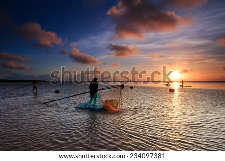There are many fishermen are fishing on the beach in sunrise, Mekong Delta, Bac Lieu, Vietnam - stock photo