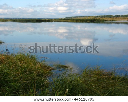 There are  river, sky and grass on bank - stock photo