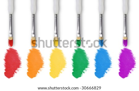 There are six paintbrushes on a white isolated background painting the colors of the rainbow. - stock photo