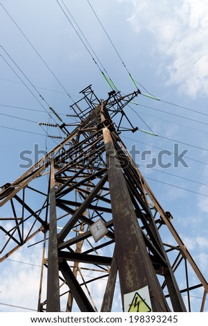 There is a electric line by an interesting angle of view under blue sky with clouds.