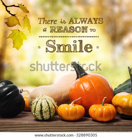 There is Always a Reason to Smile message with assorted pumpkins on rustic wooden boards
