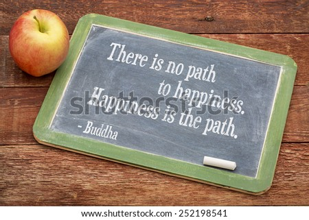 There is no path to happiness. Happiness is the path. Buddha quote  on a slate blackboard against red barn wood - stock photo