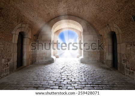 There is the light sky in the end of arch in a tunnel