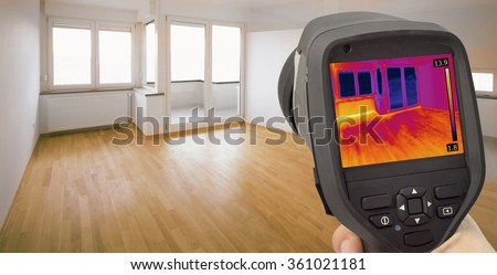 Thermal Image of Heat Leak through Windows  - stock photo