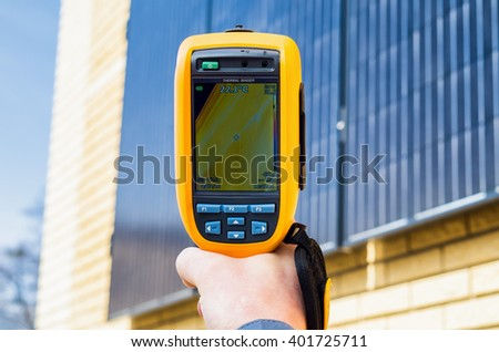 Thermal imaging inspection of solar panels on the home - stock photo